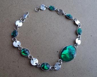 Silver (.925) bracelet with green Paua shells.