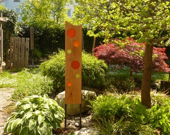 garden sculpture made of wood and glas