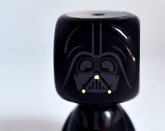 Small Darth Vader toy.  Buy and frame pictures online. Your own photo canvas easily. Use professional photos to decoration.