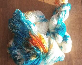 Turquoise and Orange handdyed 2ply superwash merino sock yarn