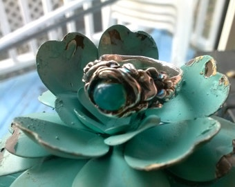 turquoise glow in silver flower