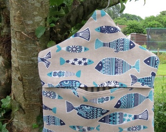 A peg bag with a fish design.  Peg storage.