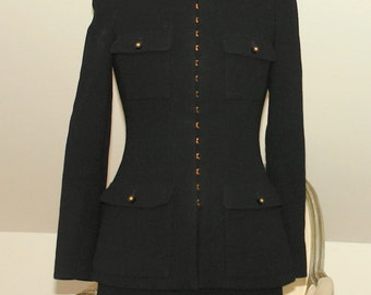 Vintage Chanel Black two pieces suit.