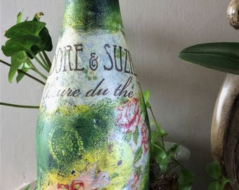 "Decorated bottle-""Isidore and Suzie tea"""