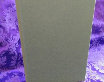 Hand made blank journal with green cloth.