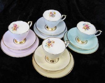 4 Sutherland (H & M) Harlequin Tea Trios, Pastel Trios with Floral Interiors: Peach, Pink, Blue and Aqua