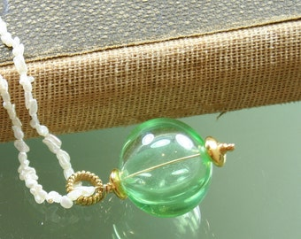 green hollow lampwork glass bead pendant