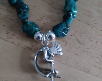 Genuine turquoise nuggets with sterling silver Kokopelli charm. 3D solid charm