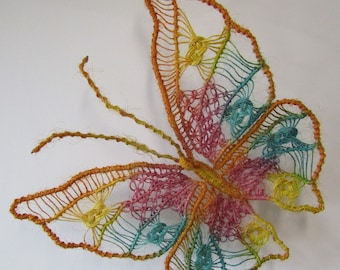 Macrame Butterfly wall decoration, handmade using hemp string painted yellow, orange, pink, turquoise