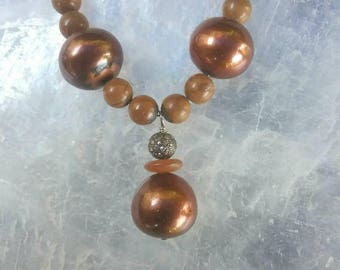 Diamond and Pearl necklace with Agate and Pyrite accents.