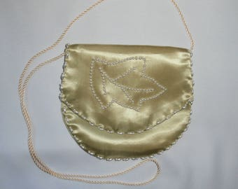Green evening bag made of satin with pearl beads