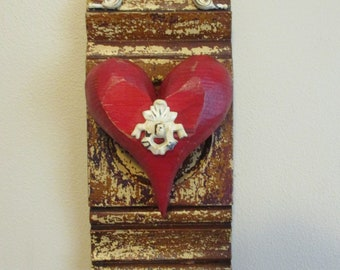 Vintage plinth block with red heart