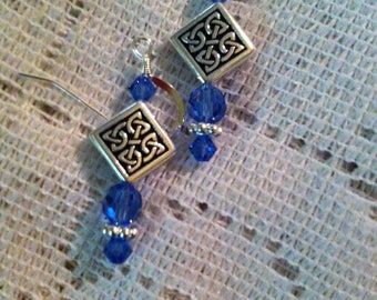 Sapphire blue and silver pierced earrings with Celtic knot beads.