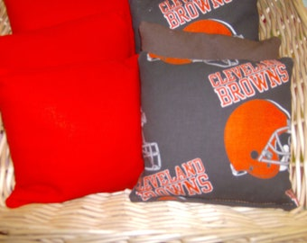 8 PC set of Corn hole Bags 4 Cleveland Browns Cotton Print and 4 Orange Duck Cloth bags.