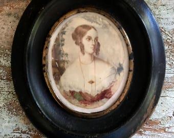 Antique miniature portrait painted on thin bone wafers.