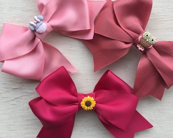 BEAUTIFUL AND UNIQUE.Bows Boutique hair bow girls ribbon-large bow w/ button detail.4.99 each.