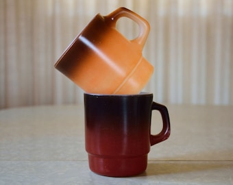 Pair of Fire King gradient, stackable coffee mugs