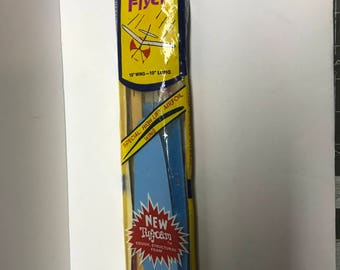 Vintage sky flyer rubber band powered airplane toy.