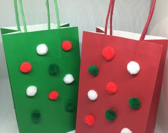 Red and green Pom Pom gift bags, set of four, 2 red, 2 green, 5inx8.5in with handle.  Christmas gift bags, red,green,and white Pom poms