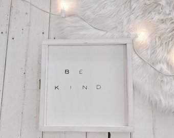 be kind black and white wooden sign
