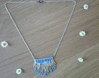 Necklace with long fringe in blue and gold bead