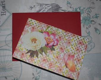 floral folded card with a red envelope