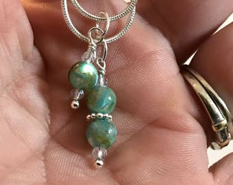 River shell and silver pendant necklace