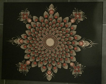 Large mandala in reds and golds
