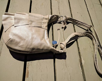 Sarah - a Pearl Beige Recycled Leather Messenger Bag with Ruffles, Zipper and Adjustable Strap
