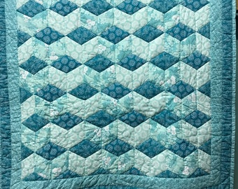 Tumbling block baby quilt