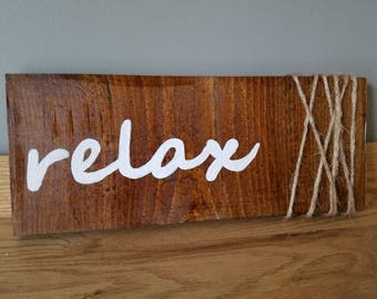 """Hand painted """"relax"""" sign with twine"""