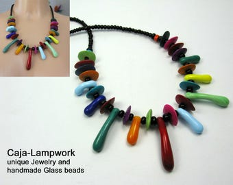 Short, colorful necklace with handmade drop beads and ceramic beads, lampwork