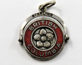 Enameled Mechanical Spinner or Flipper British Columbia with Flower in the Center Sterling Silver Charm of Pendant.