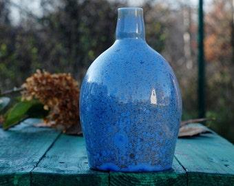 Blue pottery bottle