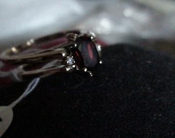 gold garnet and cz flip ring january birthstone