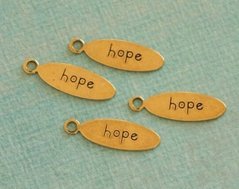 4 Oval Brass Hope Charms 2333