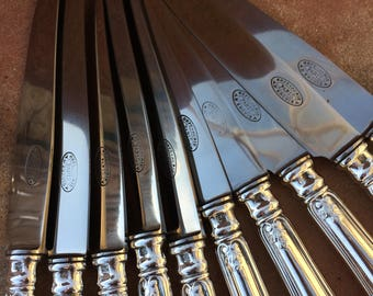 """lot 55, 10 """"ERCUIS PARIS"""" silver plated knives. silvery metal 10 knives."""