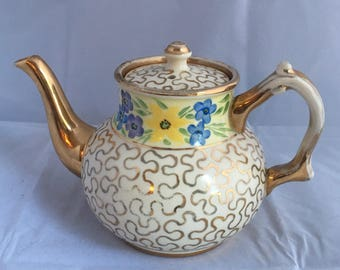Vintage English made teapot. English teapot with gold gilded swirls. Gold gilded teapot with gold gilding and pastel flowers.