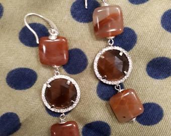 Rims and diamonds, pendant earrings.