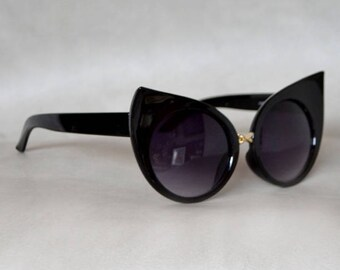 Cat eye Sunglasses with Gold Detail.