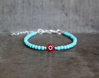 Turquoise Colored Stone Beaded Bracelet with Red Glass Evil Eye
