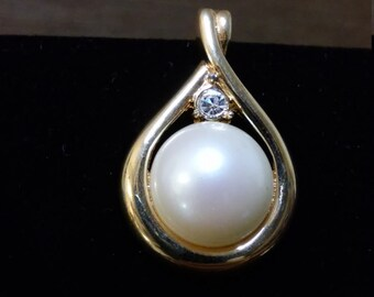 Vintage Monet clip on pendant of zirconia and faux pearl