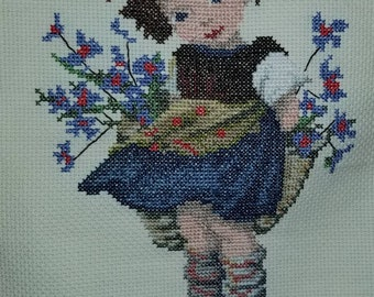 Girl with flowers - cross stitched quilt
