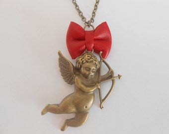 Necklace with an Angel and a red leather bow