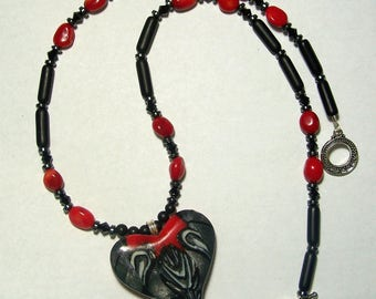 Red, Black, and White Polymer Clay Heart Pendant with Matching Beaded Necklace by Carol Wilson of Jet'adorn