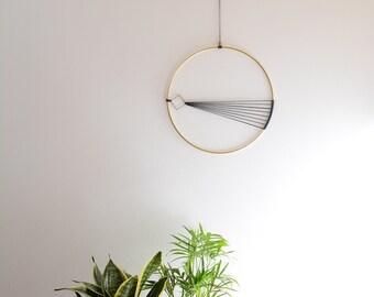 Elegant and modern brass wall hanging