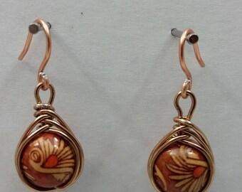 Copper drop earrings.