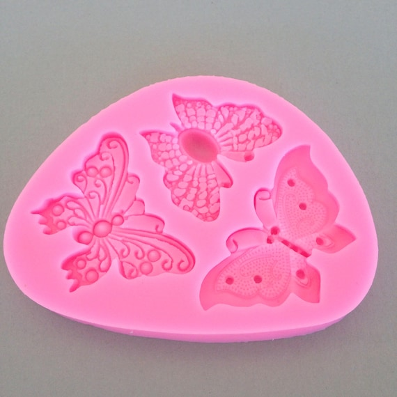 Beautiful butterfly trio food safe Silicone mold perfect for fondant, polymer clay, chocolates, candy, soap resin work and much more.