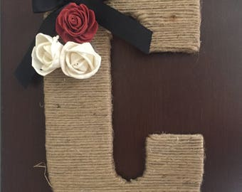 Twine letters with solo flowers