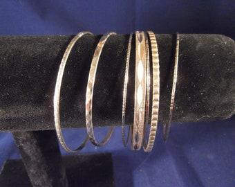 Set of 7 Gold Tone Etched Bangle Bracelets Wide and Thin, Stacking Bracelets, Cuff Bracelets